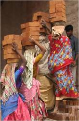 Woman Carrying Bricks